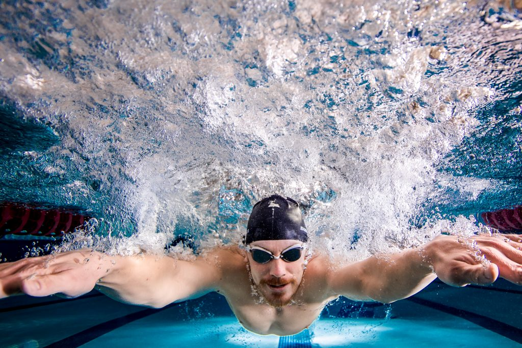 Swimmer racing toward finish line. Underwater photo.