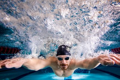 Swimmer racing toward finish line. Underwater photo.