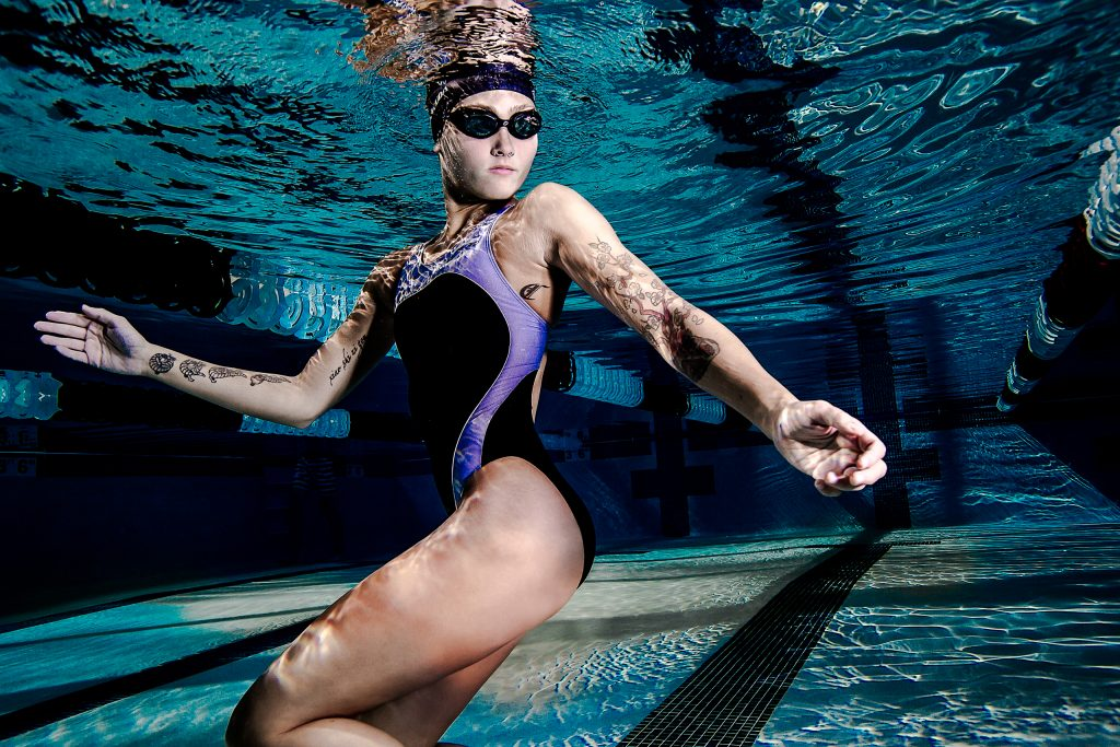 Underwater model wearing swimsuite and goggles