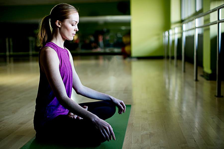 Yoga Student in Studio Sitting in Lotus
