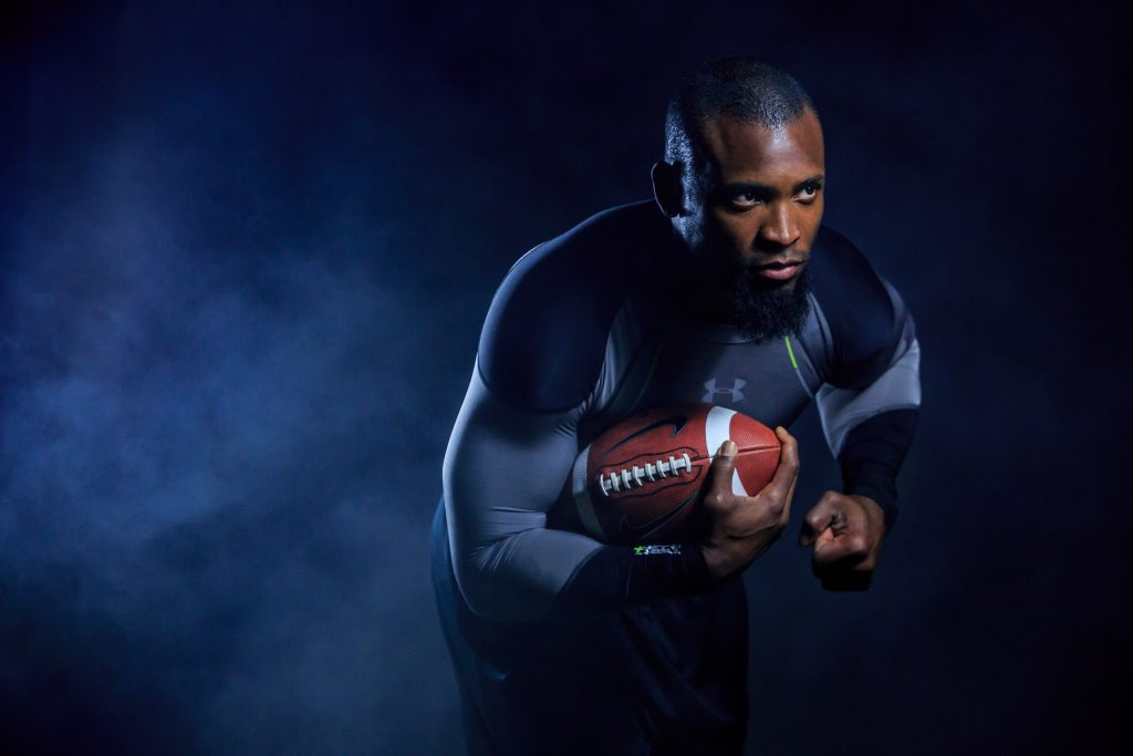 Ahman Green Portrait with smoke and football