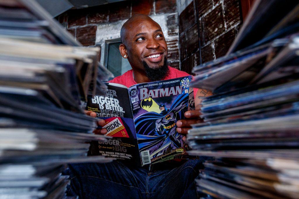 Ahman Green reading Batman comic books