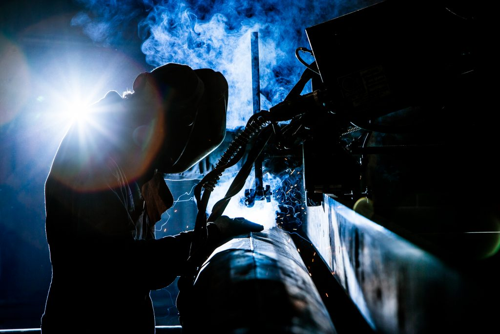 Arch Welder Working in Smoke