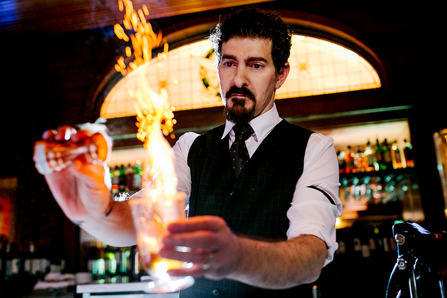 Bar tender making flaming Spanish coffee