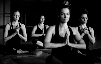 Women practicing yoga and meditating at Multnomah Athletic Club in Portland