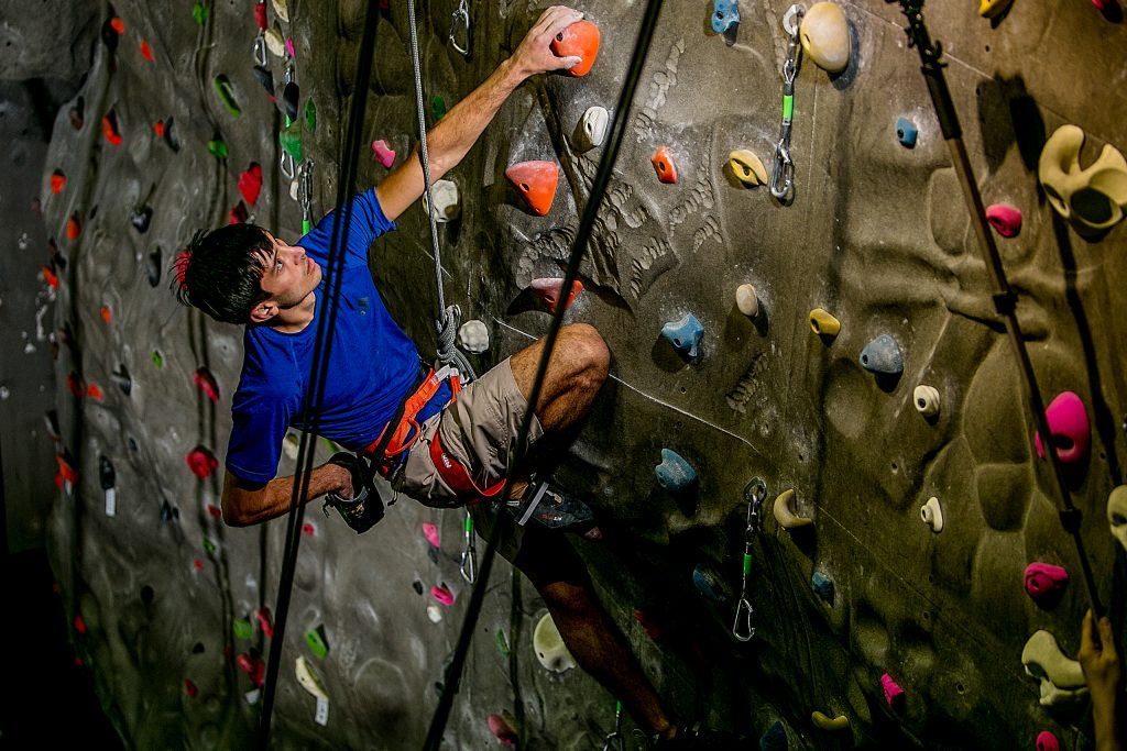Man rock climbing in Multomah Athletic Club in Portland Oregon