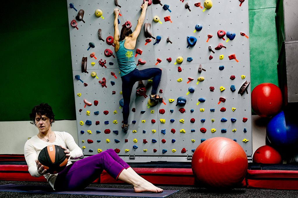 Women exercising and rock wall climbing in Multomah Athletic Club in Portland Oregon