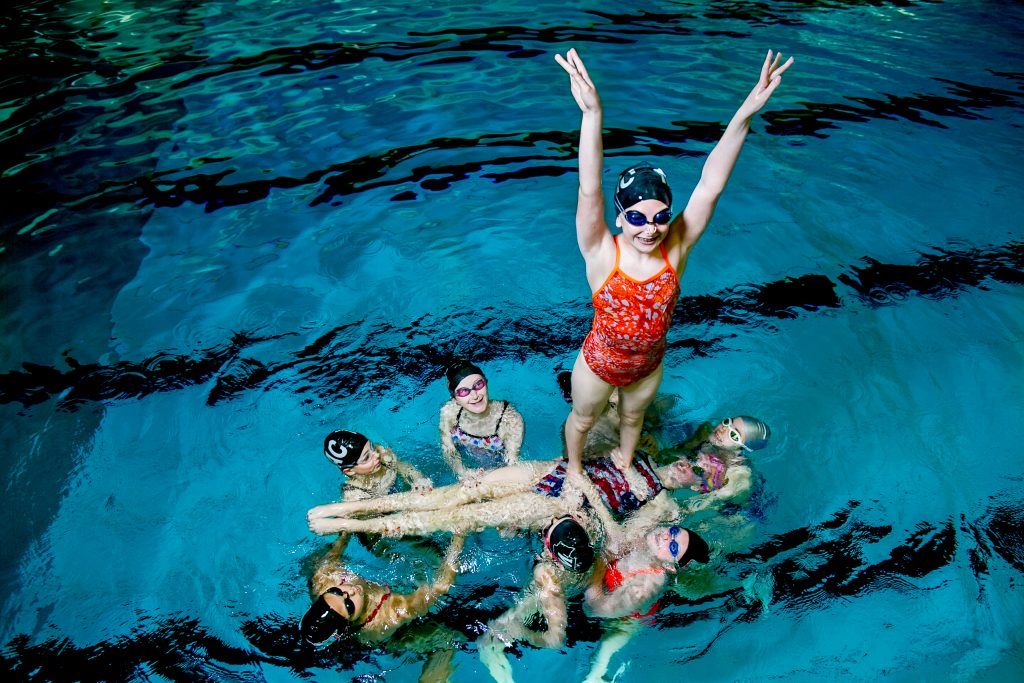 Children synchronized swimming in Multnomah Athletic Club pool