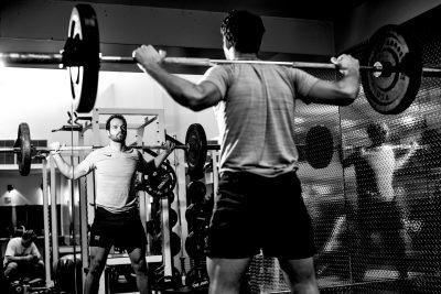 Man lifting weights in Multomah Athletic Club in Portland Oregon