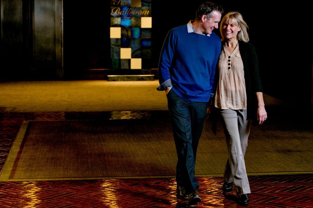 Happy couple walking in Multnomah Athletic Club in Portland Oregon