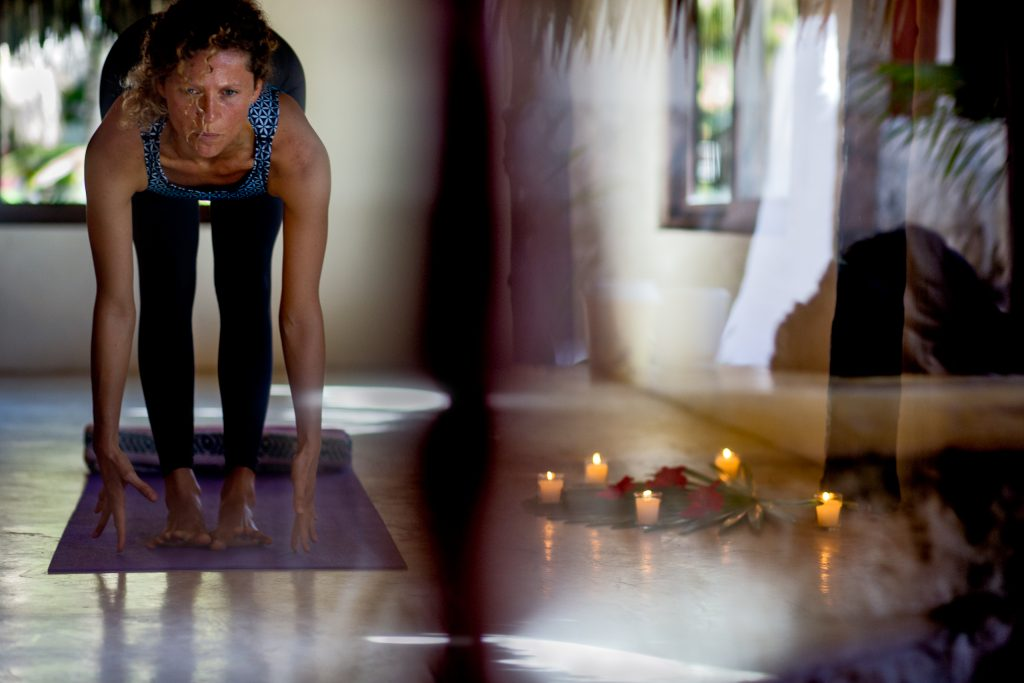 Yoga teacher leading yoga class with abstract reflections