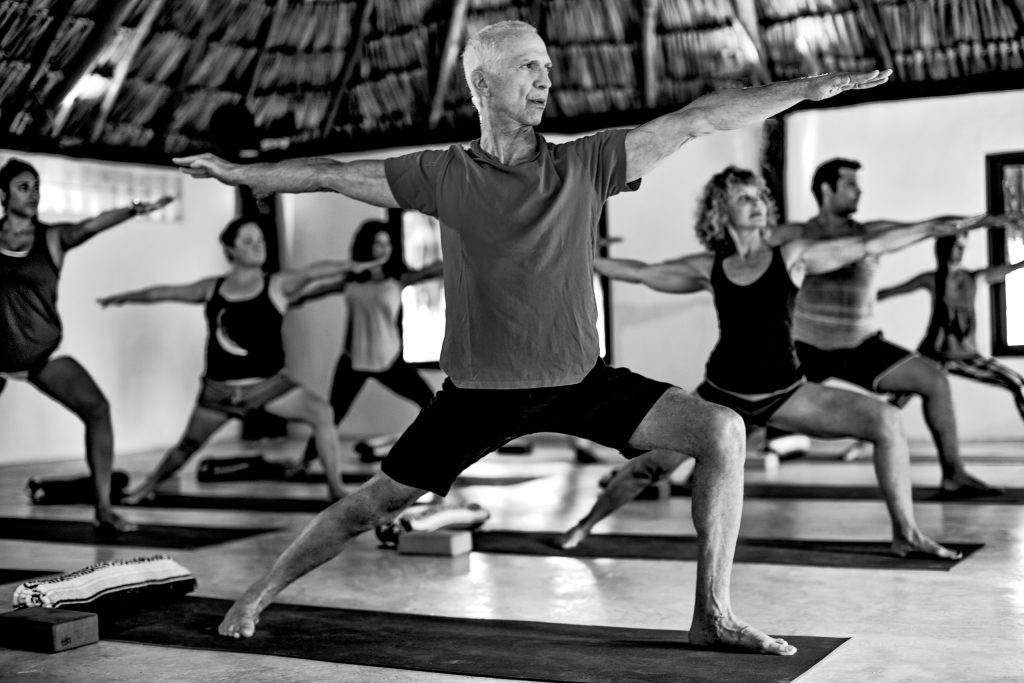 Man doing yoga at Tropical Outdoor Shower at Maya Tulum Spa and Resort