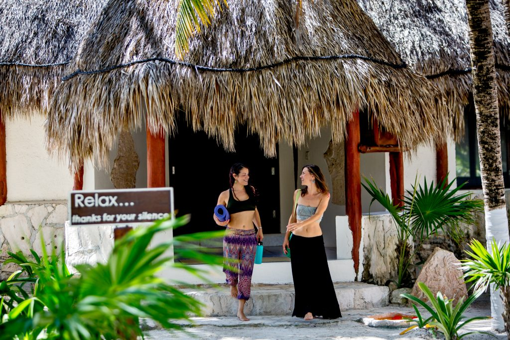 Two women walking to Yoga class in Mayatulum Mexico