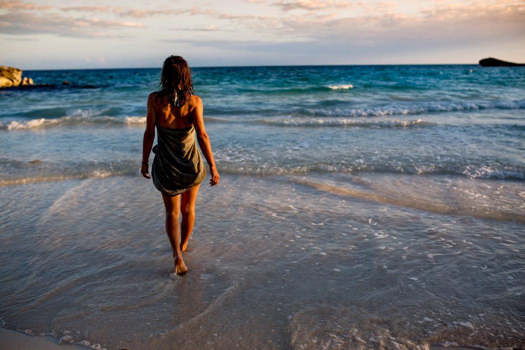 Woman walking into ocean in Maya Tulum Mexico