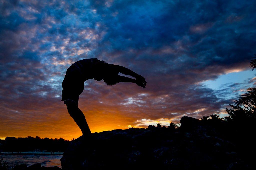 Man doing crazy backbend yoga pose in Mayatulum Mexico