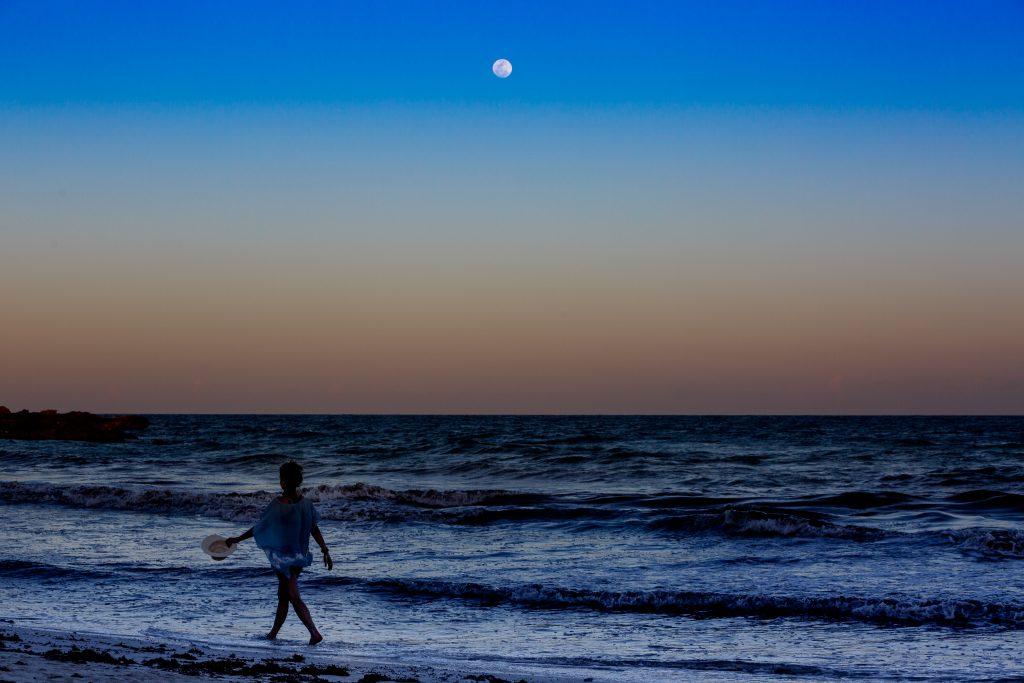 Woman walking on beach in Mayatulum Mexico