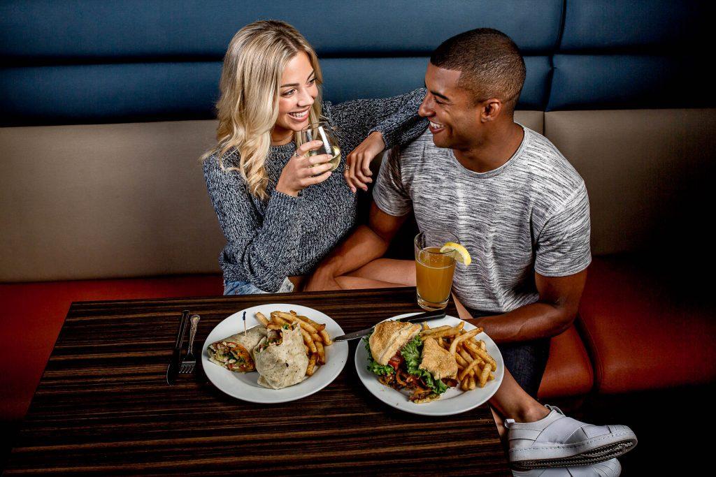 Cute couple enjoying date at Kingpin in Portland Oregon