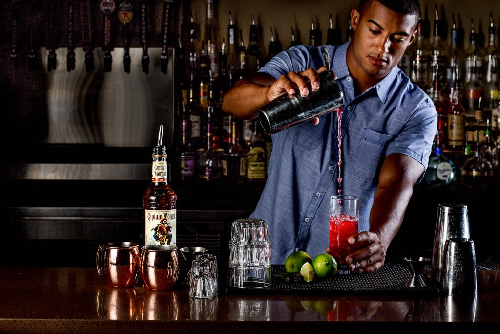 Bar tender pouring epic drink at Kingpins in Portland Oregon