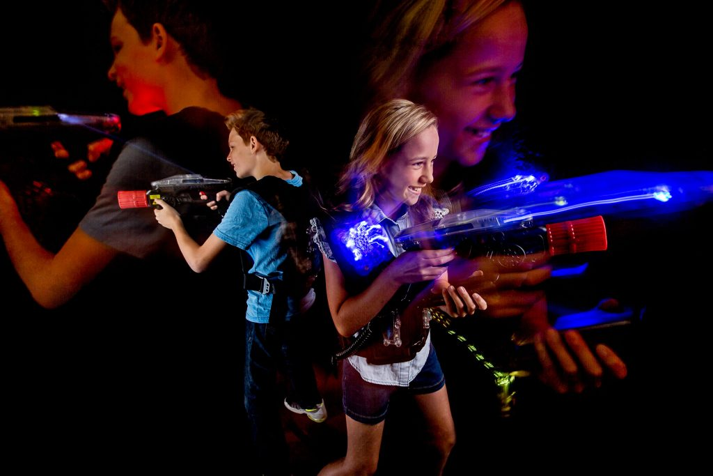 Kids playing lazer game at Kingpins bowling alley in Portland Oregon