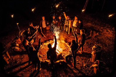 Group around large bonfire